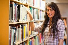 Student choosing a book Stock Image