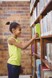 Student choosing a book at a library. At the elementary school Royalty Free Stock Photos