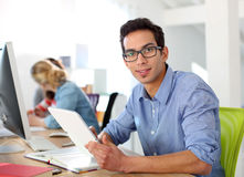 Student in class using tablet Stock Photography