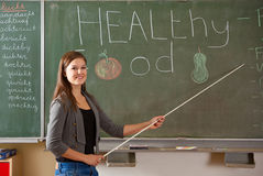 Student in classroom. Student giving a presentation in front of the class on healthy food Royalty Free Stock Photos