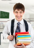 Student in the Classroom. Happy Student holding the Books in the classroom Stock Photography