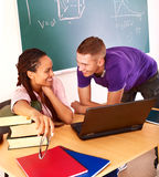 Student in classroom near blackboard. Royalty Free Stock Photos