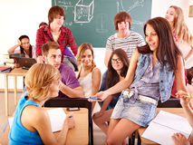 Student in classroom near blackboard. Royalty Free Stock Image