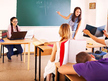 Student in classroom near blackboard. Stock Photo