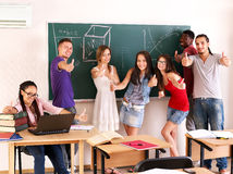 Student in classroom near blackboard. Royalty Free Stock Images