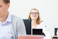 Student in the classroom. Portrait of a student in the classroom, college tuition Stock Photos