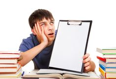 Student with a Clipboard. Bored Student with a Clipboard on the School Desk Stock Images