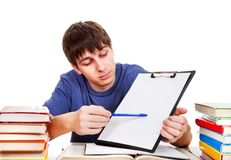 Student with a Clipboard. On the School Desk Royalty Free Stock Images