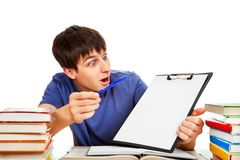 Student with a Clipboard. Surprised Student with a Clipboard on the School Desk Stock Images