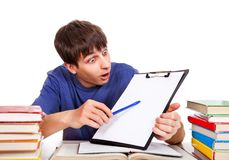 Student with a clipboard. Surprised student with a clipboard on the school desk Royalty Free Stock Images