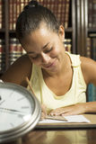 Student with Clock - Vertical stock photo