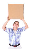 Student: College Student Holds Packing Box Over Head Stock Photo