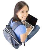 Student collegu z laptopem zdjęcia stock