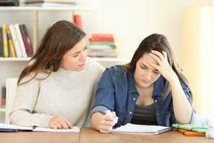 Student comforting her frustrated friend royalty free stock photo