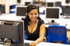 Student computer room. Beautiful female african american college student in computer room Stock Photos