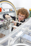 Student constructing electric vehicle prototype in vocational school Stock Image