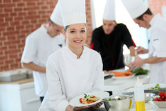 Student cooking apprentice amongst the group Royalty Free Stock Image