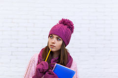 Student Copy Space Pondering Attractive Girl In Pink Hat Holding Folder Pencil Stock Photos