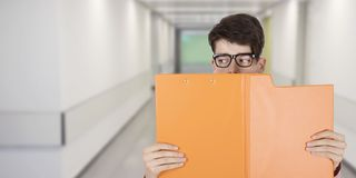 Student copying or spying. With open folder stock images