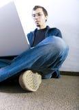 Student on corridor. Student or employee on corridor, working on laptop Stock Image