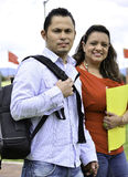 They are a student couple. They are a couple ans students, they walk at the park royalty free stock image