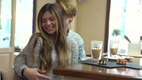Student couple chatting together in a cafe stock video