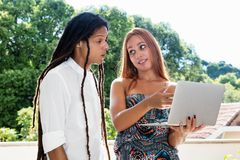 Student couple talking about the news at the web royalty free stock photos
