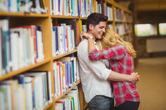 Student couple embracing each other Stock Photos