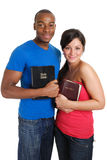Student couple holding bibles royalty free stock image