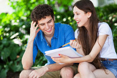 Student couple learning outdoors stock images