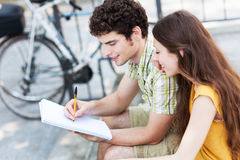 Student couple learning outdoors Stock Photo
