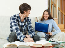 Student couple  reading, writing, preparing for the session Stock Images