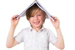 Student covering head with book Royalty Free Stock Image