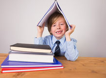 Student covering head with book Royalty Free Stock Photos