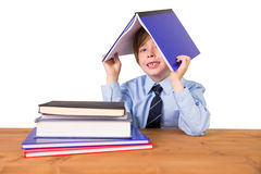 Student covering head with book Stock Photos