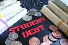 Student Debt With Stacks Of Money On Laptop Keyboard High Quality. Stock Photo Stock Images