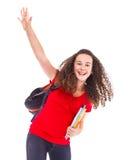 Student, der ihre Hand wellenartig bewegt lizenzfreie stockfotografie