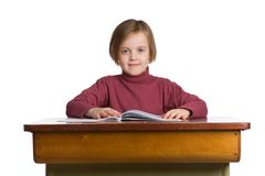 Student at desk. Girl at a school desk, isolated on a white background Stock Photos
