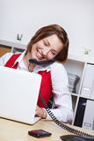 Student at desk with laptop using Royalty Free Stock Photography