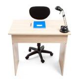 Student Desk med anteckningsbokpennan och lampan Arkivfoton