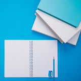 Student desk with open notebook Royalty Free Stock Photos