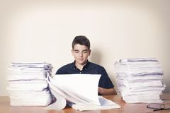 Student at the desk studying. School and children Stock Photos