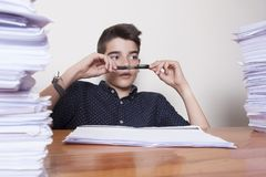 Student at the desk studying. School and children Stock Images