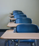 Student Desks. A row of traditional student desks stock photo