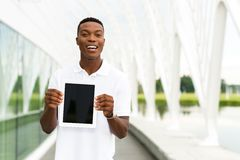 Student with Digital Tablet. Black, African American college student showing a digital tablet computer Stock Photo