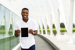 Student with Digital Tablet. Black, African American college student showing a digital tablet computer Stock Image