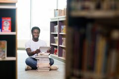 Student With Digital Tablet And Books Sitting In Royalty Free Stock Photos