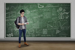 Student with digital tablet standing in class Royalty Free Stock Photos