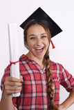 Student with diploma and graduation cap Royalty Free Stock Photography