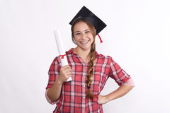 Student with diploma and graduation cap Royalty Free Stock Photo